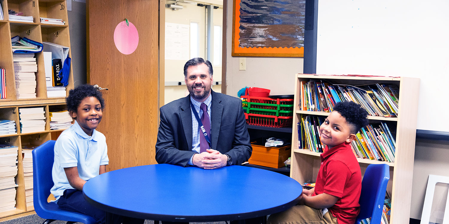 Principal Michael Jaissle with two elementary students.